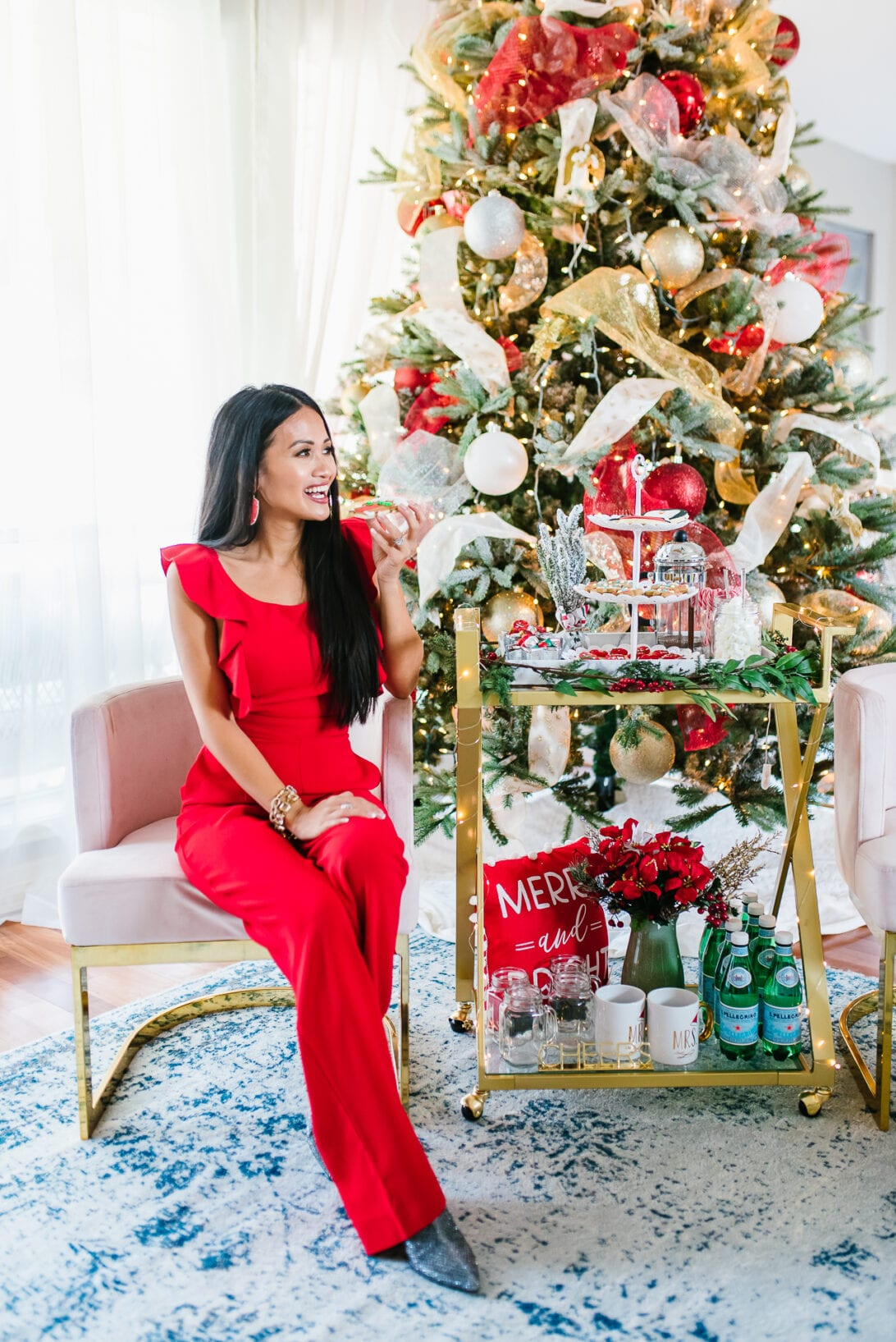 12 ft Christmas tree, Holiday hosting, hosting a party, party tips, red jumpsuit