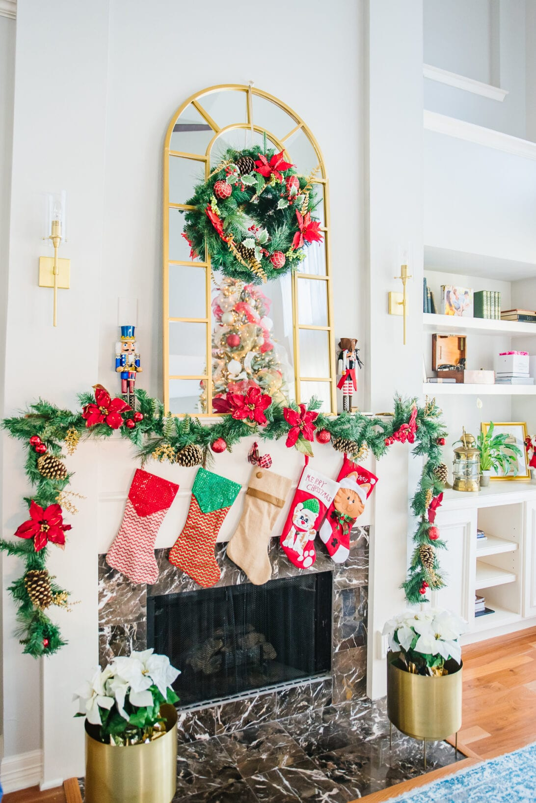 Christmas fireplace, How to decorate your fireplace for Christmas, Christmas stocking, poinsettias, red Christmas wreath, red Christmas decor