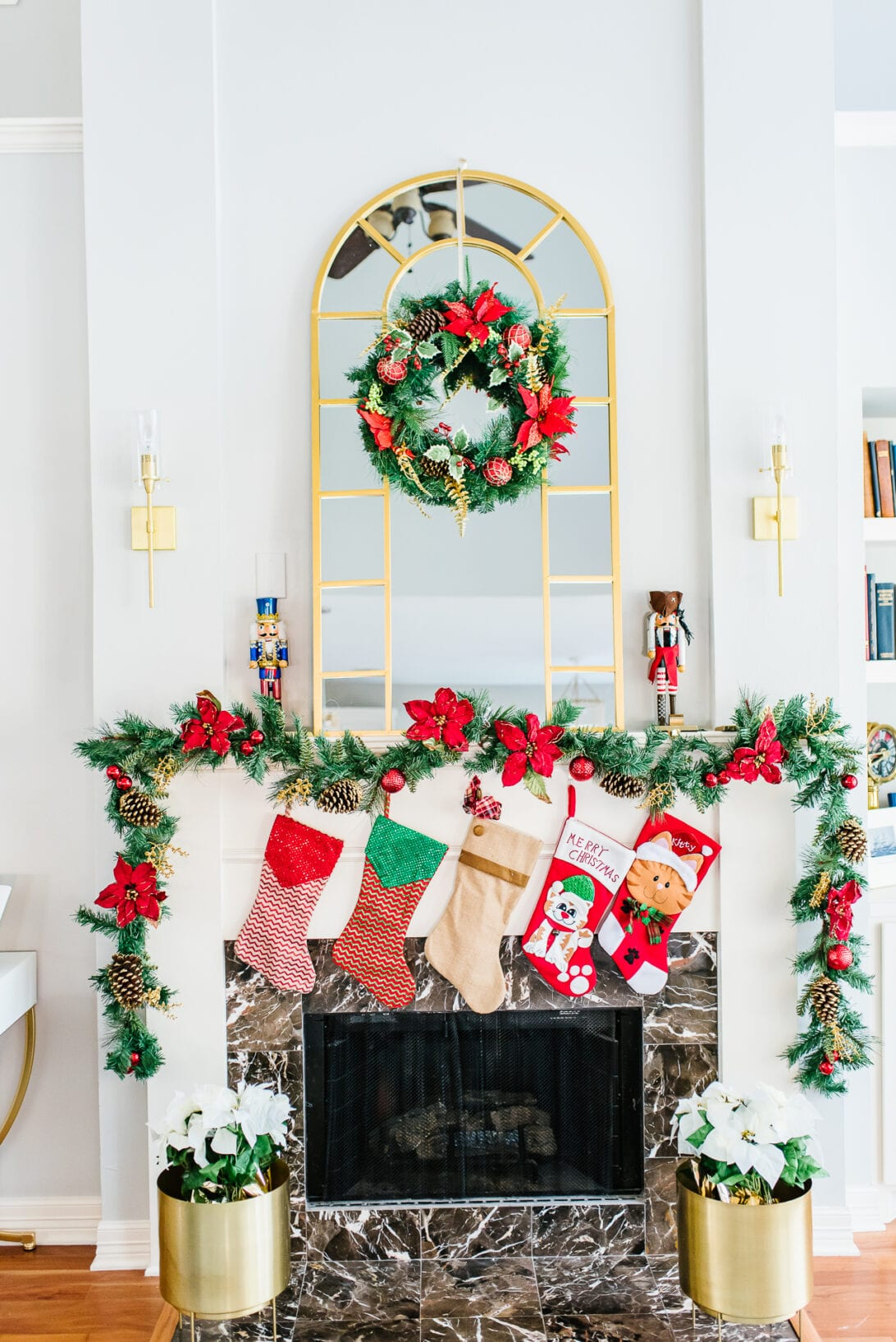 living room fireplace, Christmas fireplace decoration, Nutcrackers, poinsettias
