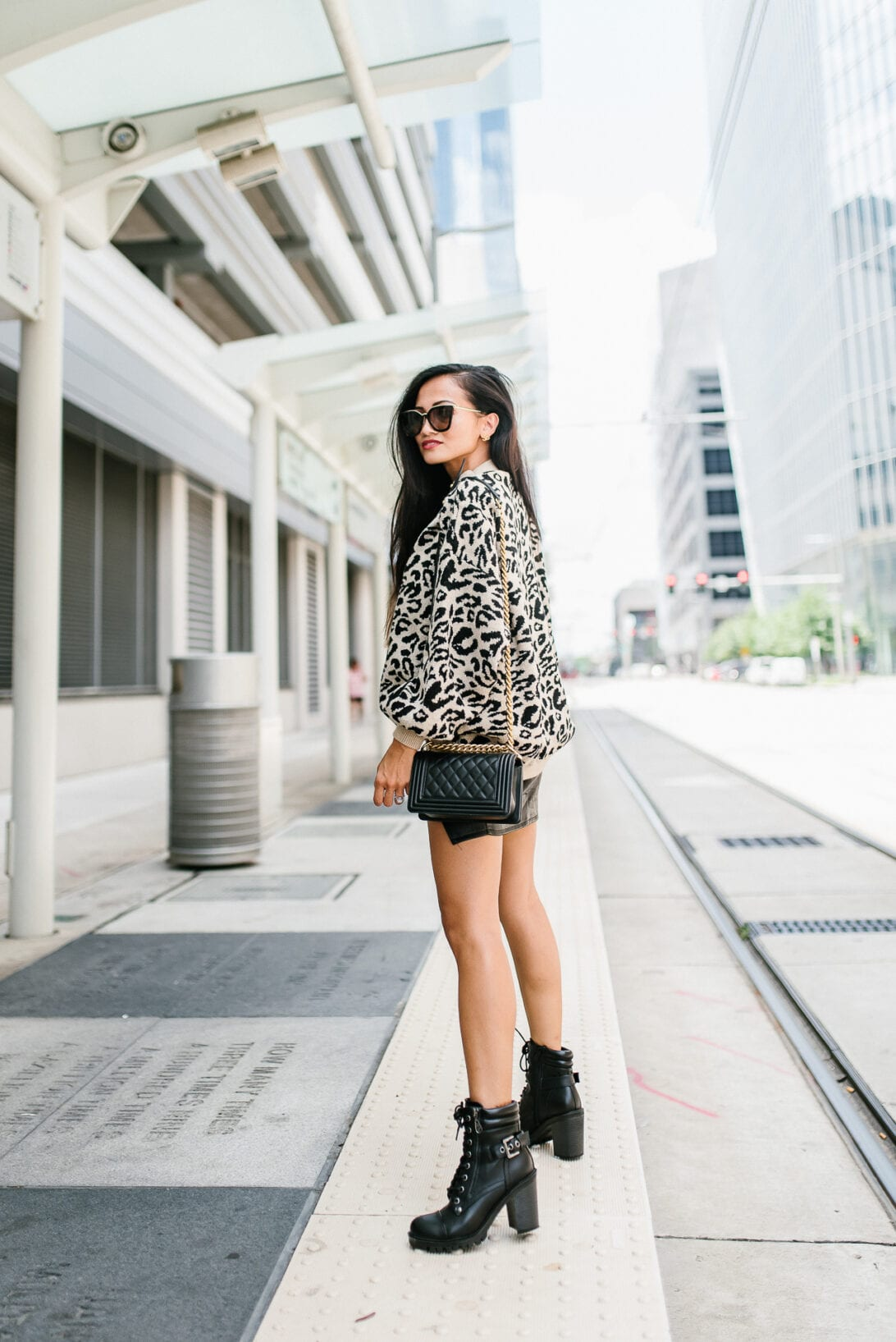 black buckle boots, black combat boots, leopard sweater