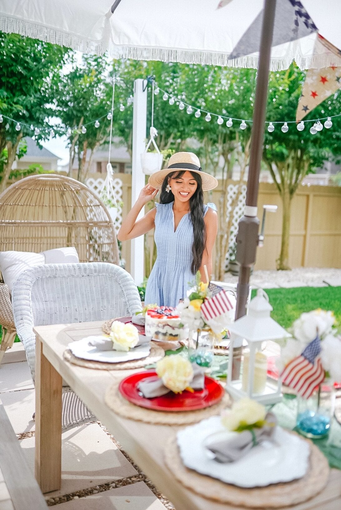 patriotic themed tablescape, patio decor, American flags, red and white chargers