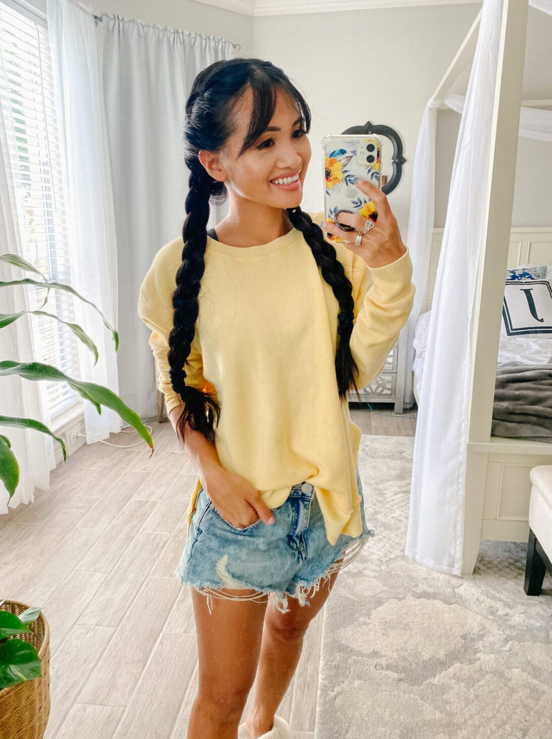 yellow sweatshirt and cut off shorts.
